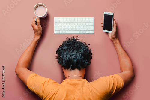 Fotografie, Obraz  Flat lay man with burn out sleeps on table with keyboard,smartphone and coffee