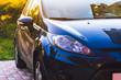 Blue car headlight closeup