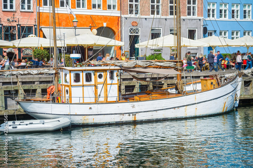 Photo  Old sailboat moored by Nyhavn