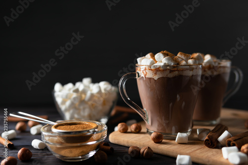 Canvas Prints Chocolate Hot drinks with marshmallows on cutting board between cinnamon