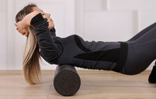 Mindful Workout Holistic Health Care. Woman Doing Foam Roller Exercises To Relieve Back Pain