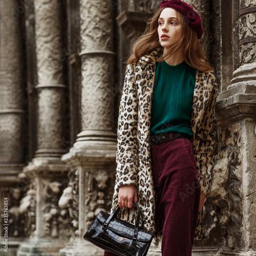 5fcae11c23e0a Outdoor fashion portrait of woman wearing trendy animal