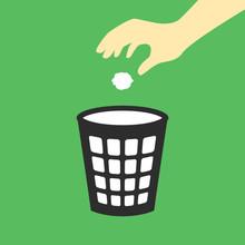 Hand Throwing Paper In Trash Bin