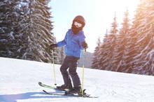 Small Boy Skiing On Slope At Mountain Ski Resort