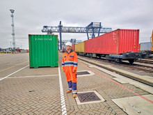 Dock Worder Standing By Freight Cargo Train Waiting To Depart