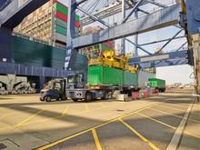 Crane Loading Cargo Container Onto Truck