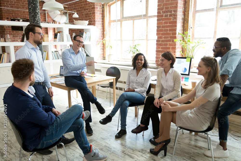 Fototapety, obrazy: Happy smiling coach, tutor, boss laughing at female employee joke at briefing, colleagues having fun together at company meeting, multiracial staff, team building training, good relationship in team