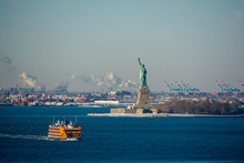 Statue Of Liberty Seen From Brooklyn On A Cold, Snowy And Sunny Winter's Day