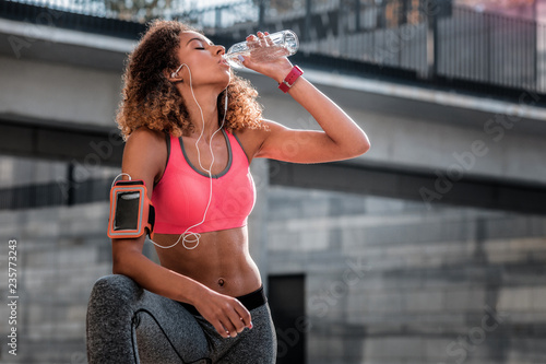 Fotografie, Obraz  Pleasant beautiful young woman being very thirsty