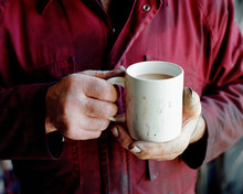 Man's Hand Holding Cup Of Tea