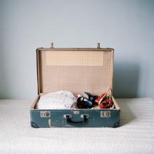 Antique Clothing In Suitcase