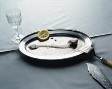 Fish Bones With Lemon Slice On Plate