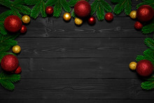 Christmas Or New Year Dark Wood Background. Xmas Black Board Framed With Season Decorations. Copy Space