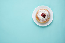 Tradition Jewish Holiday Sweets, Donut Sufganioyt With Sugar Powder And Jam On Blue Background Top View With Copy Space