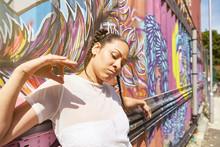 Young Woman Beside Graffiti Co...