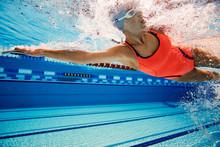 Young Woman Swimming In Swimmi...