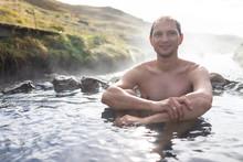 Young Happy Man Swimming Bathi...
