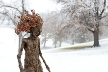 Forest Dryad Female Tree Stands Quietly In A Snowy Winter Forest Glade.