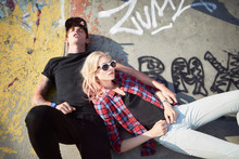 Young Couple Lying At Skate Park
