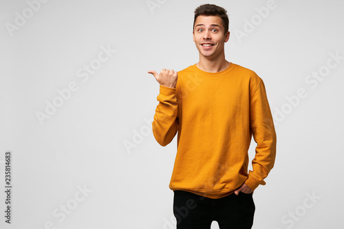 Fotografie, Obraz  Indoor photo of happy glad handsome guy,looks amazed excited, popping eyes out d