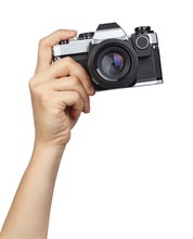 Hands Holding A Camera, Cut Out. Taking Picture.