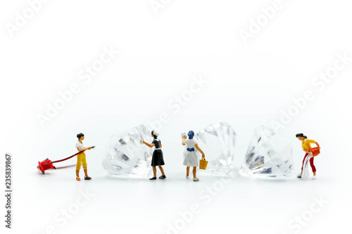 Fotografie, Obraz  Miniature people : Maid or Housewife cleaning on diamond.
