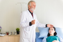 Man Doctor Using Thermometer A...