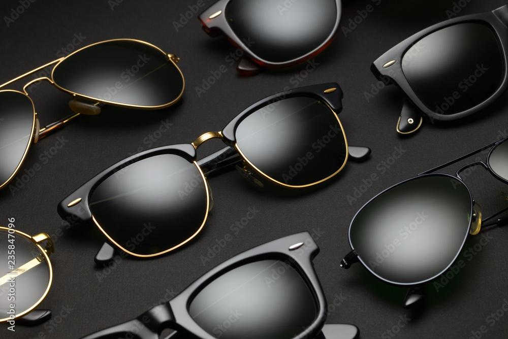 Fototapeta Old-fashioned sunglasses on black background