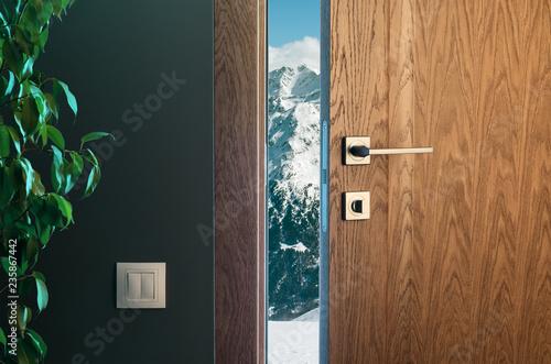 Alpine mountains behind a half-open door Canvas Print