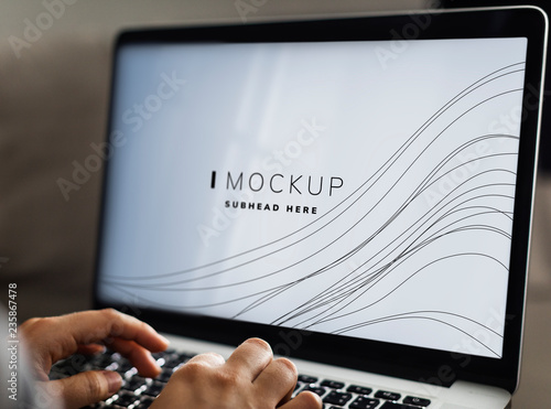 Photo Woman using a laptop with a screen mockup