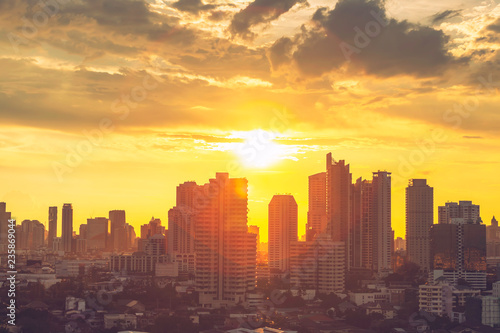 Fotobehang Stad gebouw High modern building in business city center of Bangkok at sunset. Travel to Thailand.