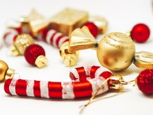 Christmas Holiday Decorations - Beads And Christmas Toys, Balls, Candy Canes Scattered On A Wooden Table, Christmas Flatley