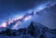 Leinwanddruck Bild - Milky Way above snowy mountains. Space. Fantastic view with snow covered rocks and starry sky at night in Nepal. Mountain ridge and sky with stars in Himalayas. Landscape with bright milky way. Galaxy
