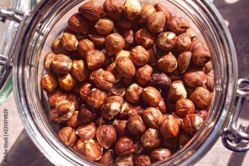 Fototapeta Peeled hazelnuts in the jar