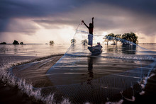 Landscape Of Thai Fisherman With Net Fish Trap In Southern Thailand.
