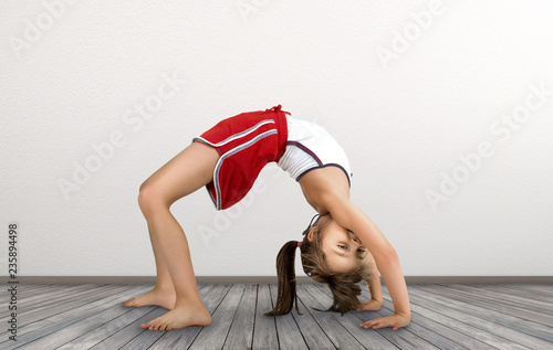 little girl doing exercises gymnastic