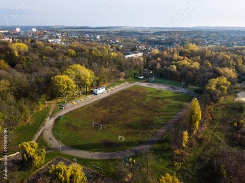 Foto op Plexiglas Stadion Aerial: Stadium in Kamianka town, Ukraine, in autumn