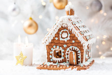 Homemade Gingerbread House  And White Candles
