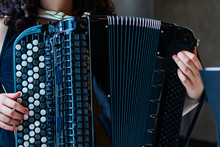 Close-up Musician Playing The Accordion On The Stage