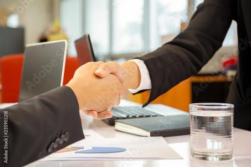 Fototapeta Successful businessmen handshak agreement after good deal in office. obraz na płótnie