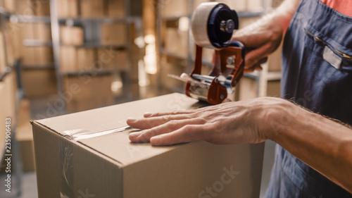 Fotografía Warehouse Worker Checks and Sealing Cardboard Box Ready for Shipment