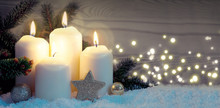 Four Burning Advent Candles Wi...
