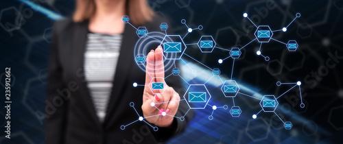 Woman touching a communication network