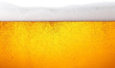 Izbliza pozadina piva s mjehurićima u staklu