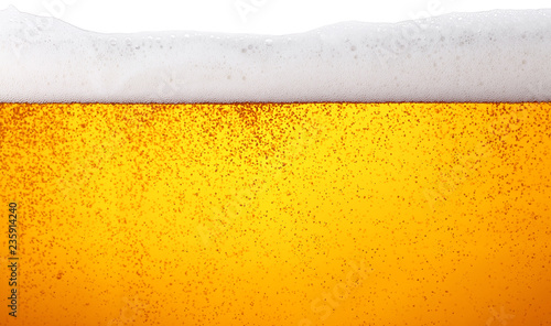 Tela  Close up background of beer with bubbles in glass