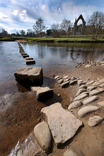 Stepping Stones Over River Wit...