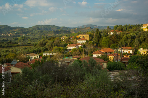 Tuinposter Donkergrijs country side space village in mountain forest south nature landscape environment in Mediterranean district of Earth in soft colors evening time