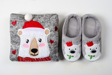 Christmas Presents. Knitted Sweater, Slippers And Hot Chocolate With Marshmallow Laid On A White Wooden Table Background. Flat Lay. Top View
