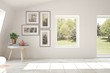 Leinwandbild Motiv White empty room with summer landscape in window. Scandinavian interior design. 3D illustration