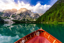 Lake Braies (also Known As Pragser Wildsee Or Lago Di Braies) In Dolomites Mountains, Sudtirol, Italy. Romantic Place With Typical Wooden Boats On The Alpine Lake.  Hiking Travel And Adventure.